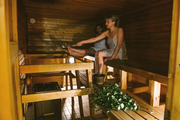 Women bathing in a sauna
