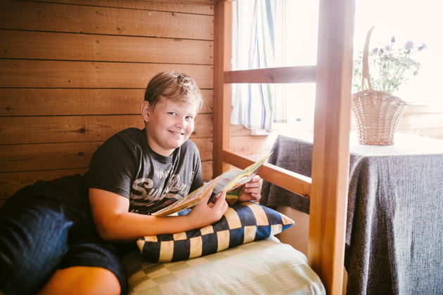 A boy reading on a bed