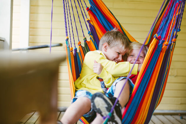 Boys playing in a hammock