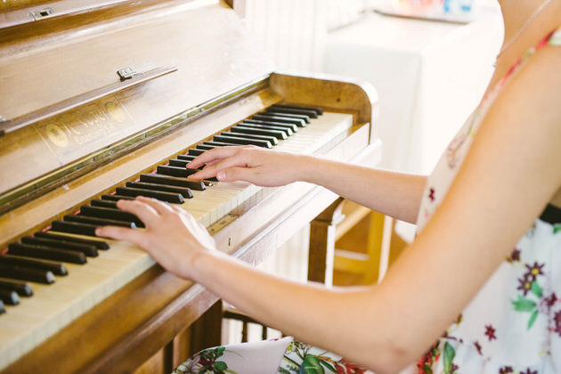 A girl playing the old piano